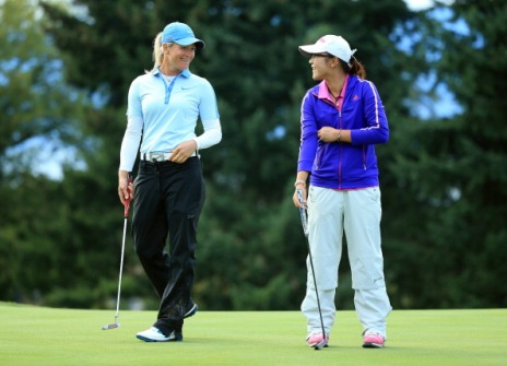 EVIAN-LES-BAINS, FRANCE - SEPTEMBER 15: Suzann Pettersen of Norway and Amateur Lydia Ko of New Zealand during the third round of The Evian Championship at the Evian Resort Golf Club on September 15, 2013 in Evian-les-Bains, France. (Photo by Richard Heathcote/Getty Images)
